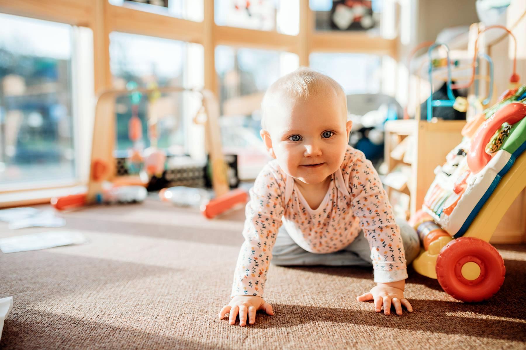 baby crawling at nursery